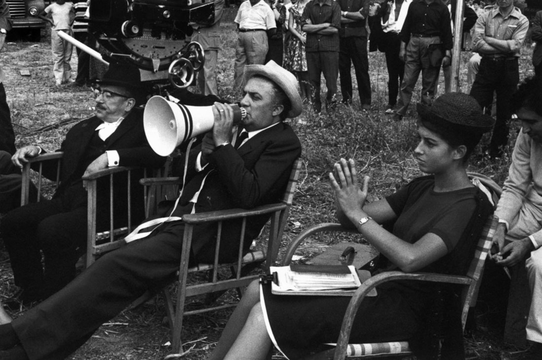 "ITALY. Rome. Movie industry. Federico FELLINI (white hat), Italian film-maker, shooting ""Boccacio 70"" (Boccace 70). Cinecitta. 1961."